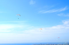 Paraglider in the blue sky Stock Images