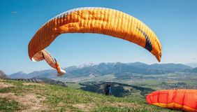 Paraglider catch a wind with his paraplane Stock Photography