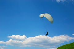 Paraglider on a cloud. Paragliding on a sunny day with various clouds in the blue sky Royalty Free Stock Photography