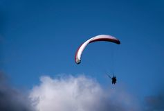 Paraglider in the clouds. At Bobs Peak, Queentown, Otago, South island,  New Zealand Royalty Free Stock Photos