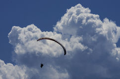 Paraglider with clouds and blue sky Royalty Free Stock Photos