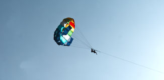Paraglider couple in skies of Goa India Royalty Free Stock Image