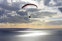 Paraglider at dusk Stock Photo