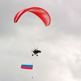 Paraglider with flag Royalty Free Stock Photography