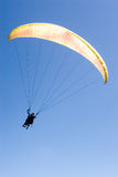 Paraglider Flies into the Blue royalty free stock photos