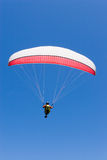 Paraglider Flies Into the Blue. Paraglider flyinginto a clear blue sky Stock Photos