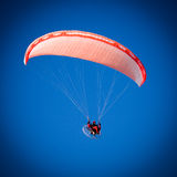 Paraglider. A Paraglider flies in the blue sky Stock Images