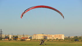 Paraglider flies low over the ground, summer stock footage