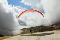 Paraglider flies from Mount Tahtali, Turkey Stock Photo