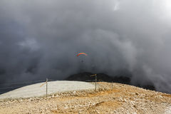 Paraglider flies from Mount Tahtali, Turkey Royalty Free Stock Photography