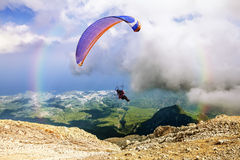 Paraglider flies from Mount Tahtali, Turkey Stock Images