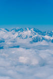 The paraglider flies over the clouds in the Caucasus Mountains Royalty Free Stock Photos