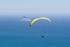 Paraglider Flies Over Ocean Royalty Free Stock Photography