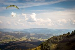 Paragliders are flying in the mountains stock image