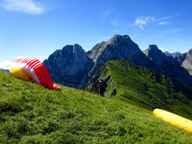 Paraglider flight with blue skies Royalty Free Stock Photo