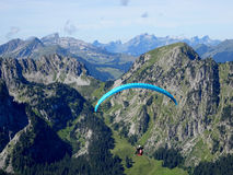 Paraglider flight with blue skies Royalty Free Stock Images