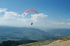 Paraglider in flight Stock Photography