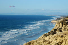 Paraglider in flight over La Jolla Cove Royalty Free Stock Image