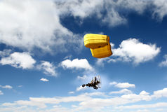 Paraglider fly. Yellow aircraft flying blue sky white cloud Royalty Free Stock Image