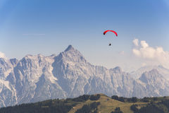Paraglider flyes over mountains in Alps, Austria Royalty Free Stock Photos