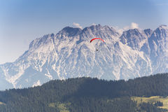 Paraglider flyes over mountains in Alps, Austria Royalty Free Stock Photo
