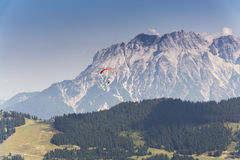 Paraglider flyes over mountains in Alps, Austria Royalty Free Stock Photography