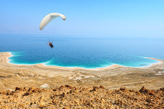 Paraglider flying above the Dead Sea Royalty Free Stock Images