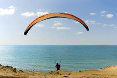 Paraglider flying above Mediterranean Royalty Free Stock Image