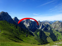 Paraglider flying with blue skies Royalty Free Stock Photos