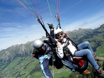 Paraglider flying with blue skies Stock Photos