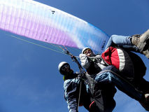 Paraglider flying with blue skies Royalty Free Stock Photography