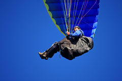 Paraglider. Flying in a blue sky Stock Photo