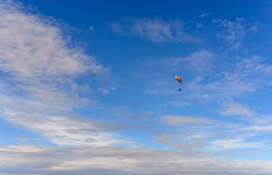 Paraglider flying blue sky Royalty Free Stock Photography