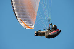 Paraglider flying in a blue sky Stock Image