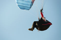Paraglider flying in a blue sky Stock Photography