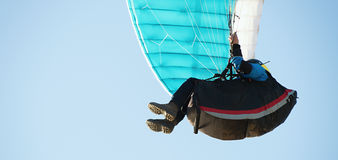 Paraglider flying in a blue sky Royalty Free Stock Photos
