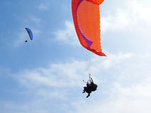 Paraglider is flying in the blue sky Royalty Free Stock Photo