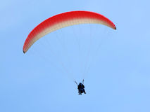 Paraglider is flying in the blue sky Stock Photo