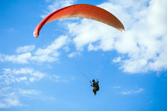 Paraglider flying on blue sky Royalty Free Stock Images