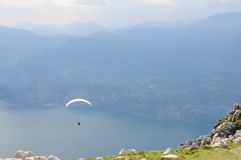 Paraglider is flying in front of mountain landscape of Alps - Mo Stock Image