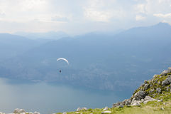 Paraglider is flying in front of mountain landscape of Alps - Mo. Paraglider is flying in front of mountain landscape of Italian Alps - Monte Baldo Royalty Free Stock Photography
