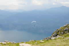Paraglider is flying in front of mountain landscape of Alps - Mo Royalty Free Stock Photo