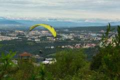 Paraglider flying from Mishennaya hills Royalty Free Stock Images