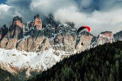 Dolomites Italian Alps Mountains. Paraglider flying near high mountains. Dolomites, Italy Royalty Free Stock Image