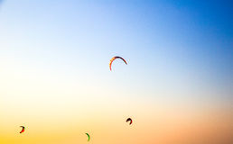 Paraglider flying over a beach Stock Photos