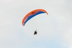 Paraglider flying over a blue sky Stock Photos