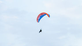 Paraglider flying over a blue sky Royalty Free Stock Images