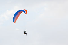 Paraglider flying over a blue sky Stock Photography