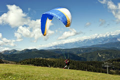 Paraglider flying over the Italian Alps Royalty Free Stock Image