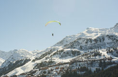 Paraglider flying over a mountain valley Royalty Free Stock Image